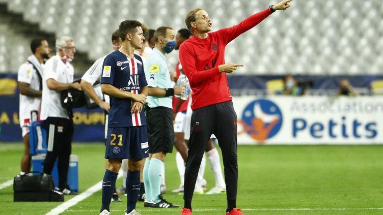 L'entraîneur du PSG Thomas Tuchel et le milieu de terrain Ander Herrera, le 31 juillet 2020 lors de la finale de la Coupe de la Ligue. (GEOFFROY VAN DER HASSELT / AFP)