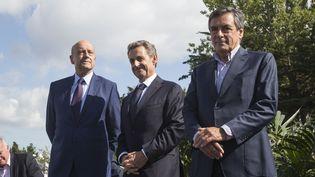 Alain Juppé, Nicolas Sarkozy et François Fillon, le 5 septembre 2015 à La Baule (Loire-Atlantique), lors de l'université d'été des Républicains. (CITIZENSIDE / CAROLINE PAUX / AFP)