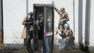 L'oeuvre de l'artiste de street-art Banksy à Cheltenham, ici en avril 2014, qui a été détruite fin août 2016.  (Ben Birchall/AP/SIPA)