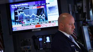 Un traderdans la salle des marchés duNew York Stock Exchange (Etats-Unis), le 21 juin 2012. (SPENCER PLATT / GETTY IMAGES NORTH AMERICA)