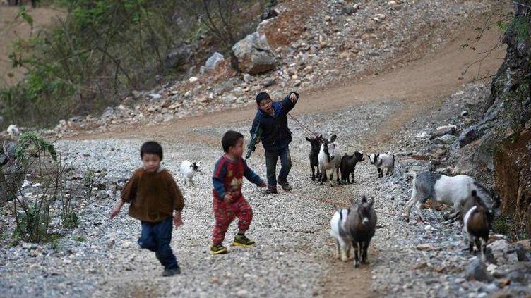 Des millions d'enfants chinois vivent sans leurs parents. (AFP)