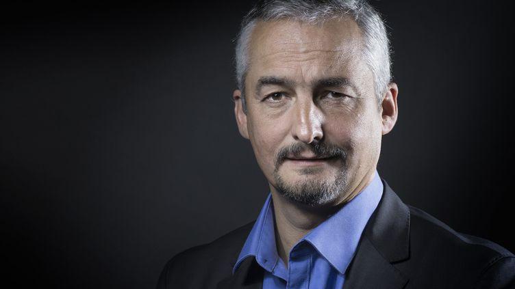 """Gilles Legardinier publie """"Le premier miracle"""" (Flammarion)  (JOEL SAGET / AFP)"""