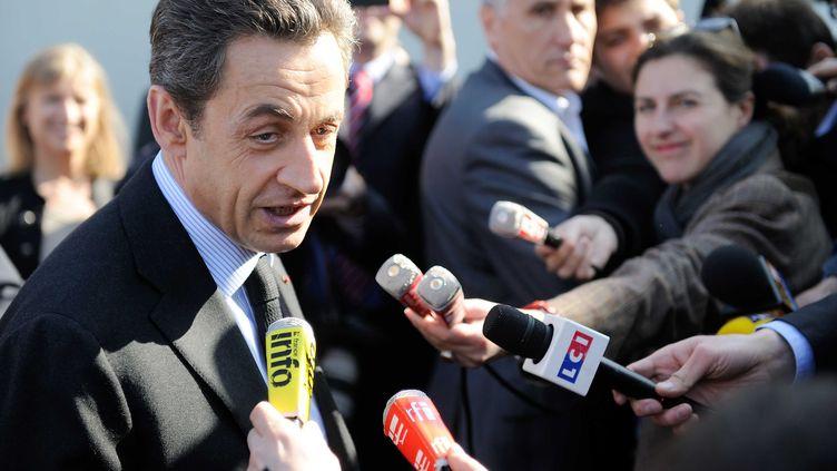 Le candidat Nicolas Sarkozy lors d'un déplacement à Suippes (Marne), le 15 mars 2012. (CHAMUSSY / SIPA)