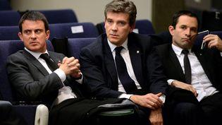 Manuel Valls, Arnaud Montebourg et Benoît Hamon, le 27 novembre 2013, lors d'une conférence de presse à Madrid, en Espagne. (GERARD JULIEN / AFP)