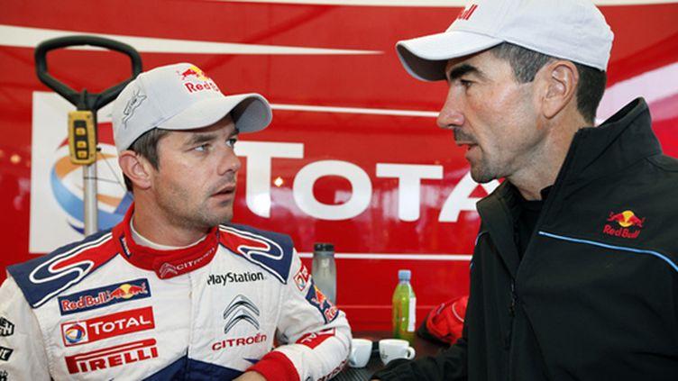 Sébastien Loeb discute avec Luc Alphand avant le rallye d'Alsace 2010