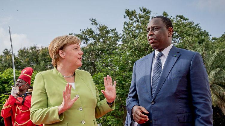 Le Sénégal, première étape de la tournée d'Angela Merkel en Afrique de l'ouest (MICHAEL KAPPELER )