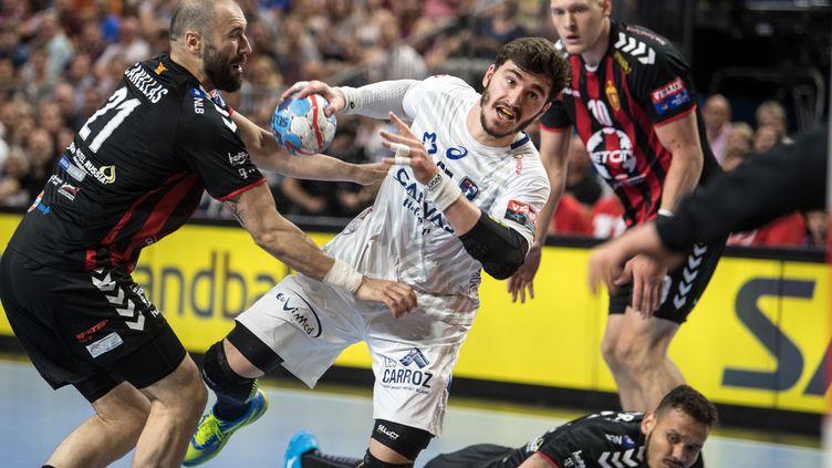 Le joueur de Montpellier Ludovic Fabregas (au centre) lors de la demi-finale de la Ligue des Champions de handball contre le Vardar Skopje, le 26 mai 2018 à Cologne (MAXPPP)