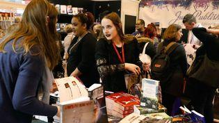 Visiteurs au Livre Paris 2018  (PATRICK KOVARIK / AFP)