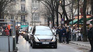 Le 12 janvier, l'arrivée du cortège à l'entrée du cimetière Montmartre.  (P LE FLOCH/SIPA)