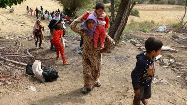 Des centaines de femmes et d'enfants de la minorité yazidie en Irak servent d'esclaves sexuels aux djihadistes de Daech. (Huseyin BAGIS / Anadolu Agency)
