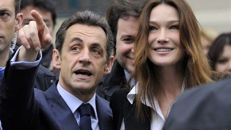 Nicolas Sarkozy et Carla Bruni le 21 mars dernier (2e tour des régionales) (AFP/PHILIPPE WOJAZER)