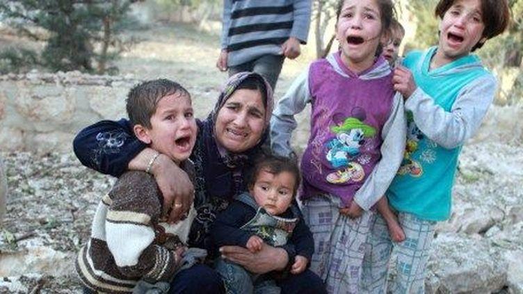 Après un bombardement d'un quartier d'Alep par l'avation de Bachar al-Assad, le 28 décembre 2013. (AFP/ Samet Dogan)