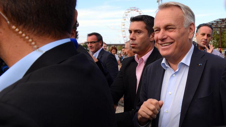 Le premier Ministre, Jean-Marc Ayrault, à son arrivée à l'univesité d'été du PS. La Rochelle, le 24 Aout 2013. (ALAIN JOCARD / AFP)