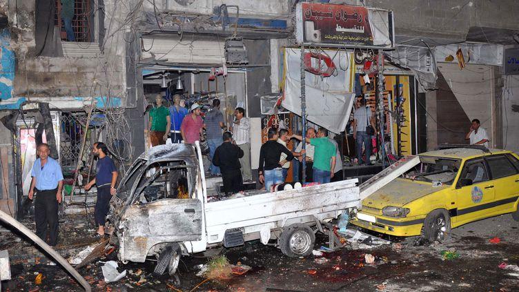 Le 6 août 2013, Jaramanaavait déjà été secouée par un attentat à la voiture piégée, qui avait tué 18 personnes. ( SANA / AFP)