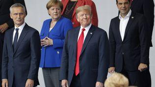 De gauche à droite : Jens Stoltenberg, Secrétaire général de l'Otan, Angela Merkel, la chancelière allemande, le président des Etats-Unis, Donald Trump et le Premier ministre grec Alexis Tsipras, réunis pour le sommet de l'Otan, à Bruxelles (Belgique) le 11 juillet 2018. (GEOFFROY VAN DER HASSELT / AFP)