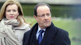 Valérie Trierweiler etFrançois Hollande, le 6 avril 2013, à Tulle (Corrèze). (JEAN-PIERRE MULLER / AFP)