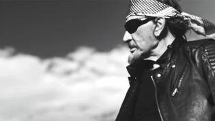 """Johnny Hallyday dans le clip de """"J'en parlerai au diable"""".  (saisie écran / Warner)"""