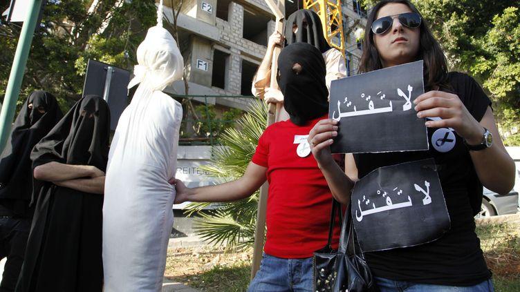 Des activistes dénoncent les éxécutions en Arabie Saoudite devant l'ambassade à Beyrouth, le 1er avril 2010. (BILAL HUSSEIN / AP/ SIPA)