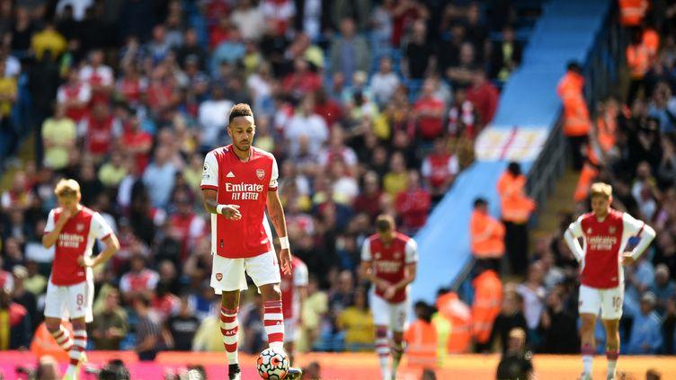Arsenal est complètement dépassé face à Manchester City. (OLI SCARFF / AFP)