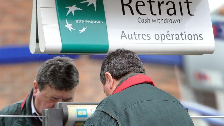 Les syndicats de l'établissement BNP Paribas ont annoncé la suppression de 373 postes en France, le 16 novembre 2011. (PHILIPPE HUGUEN / AFP)