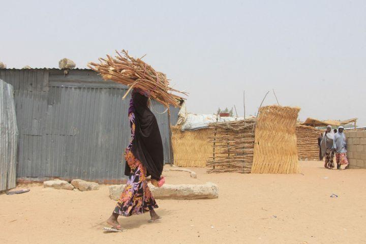 Retourner vivre chez soi n'est pas une option pour ces déplacés. Ici au moins ils sont en sécurité. Personne ne veut revivre sous la menace de Boko-Haram ou de l'Iswap. (AUDU MARTE / AFP)