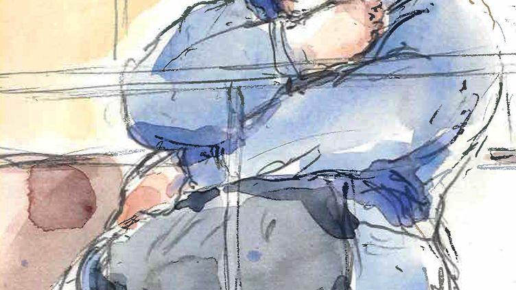 Stéphane Moitoiret lors du premier jour de son procès devant la cour d'assises d'appel du Rhône, le 12 novembre 2013. (BENOIT PEYRUCQ / AFP)