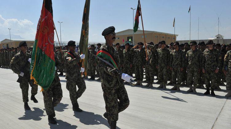 Des soldats de l'Armée nationale afghane sur la base militaire américaine de Bagram, le 10 septembre 2012. (SHAH MARAI / AFP)