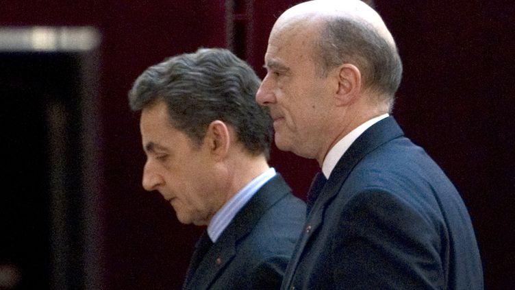 Nicolas Sarkozy et Alain Juppé, le 20 janvier 2012, à l'Elysée, à Paris. (CHARLES PLATIAU / AFP)