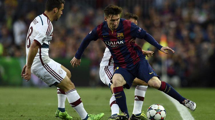 Lionel Messi lors d'un match à Barcelone, le 6 mai 2015. (LLUIS GENE / AFP)