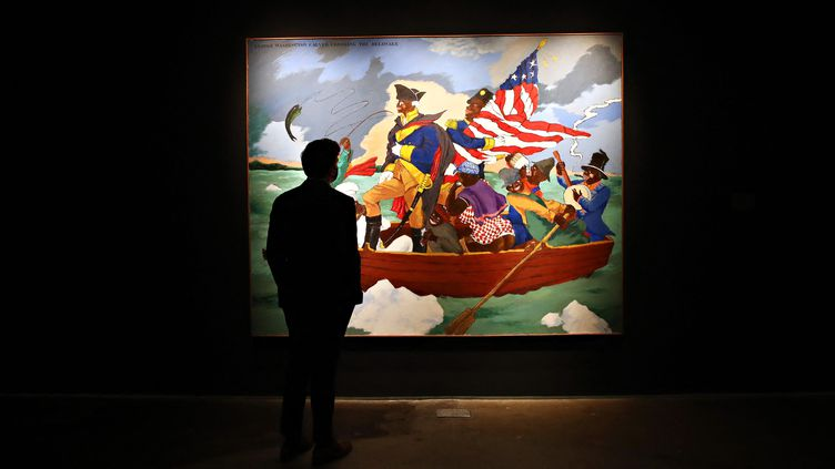 """""""George Washington Carver Crossing the Delaware: Page from an American History Textbook"""" de Robert Colescott exposé chez Sotheby's à New York, le 3 mai 2021. (CINDY ORD / GETTY IMAGES NORTH AMERICA)"""