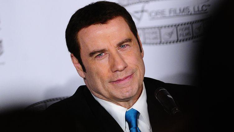 John Travolta lors d'une conférence de presse à New York (Etats-Unis) le 12 avril 2012. (EMMANUEL DUNAND / AFP)