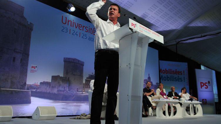 le ministre de L'intérieur Manuel Valls lors de son discours, samedi 24 août, à l'université d'été du Parti socialiste à La Rochelle (Charente-Maritime) (ALAIN JOCARD / AFP)