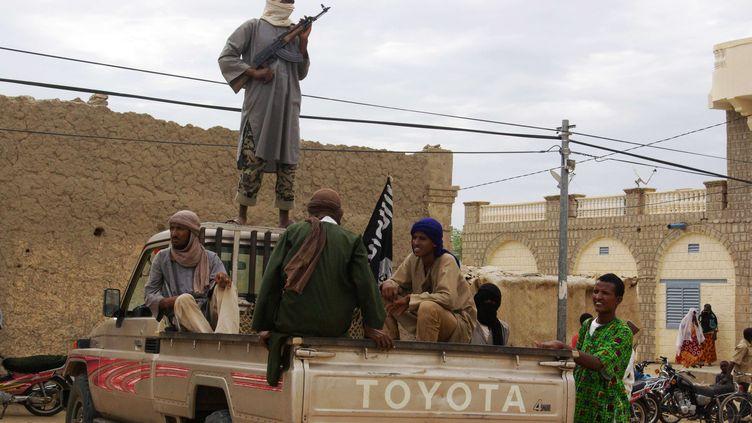 Des combattants du groupe islamiste Ansar Dine à Tombouctou, au Mali, le 31 août 2012. (AP / SIPA)
