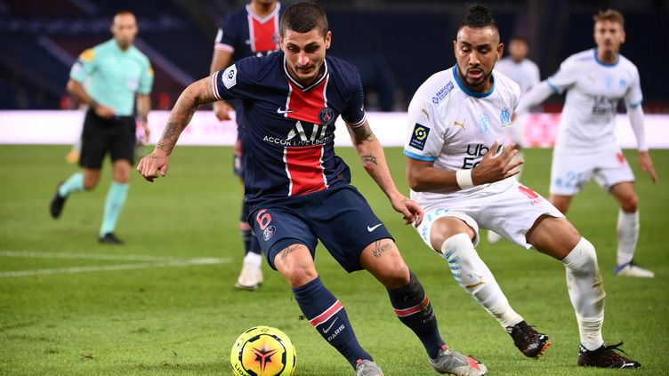 Marco Verratti, ici devant Dimitri Payet, ne sera pas sur le terrain ce soir contre Metz. (FRANCK FIFE / AFP)