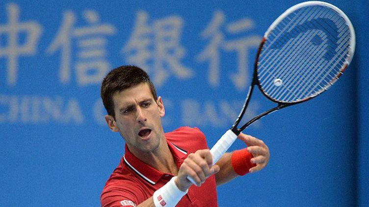 Novak Djokovic  (GOH CHAI HIN / AFP)