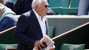 L'ancien directeur du FMI Dominique Strauss-Kahn dans les allées de Roland-Garros le 30 mai 2015. (AFP)