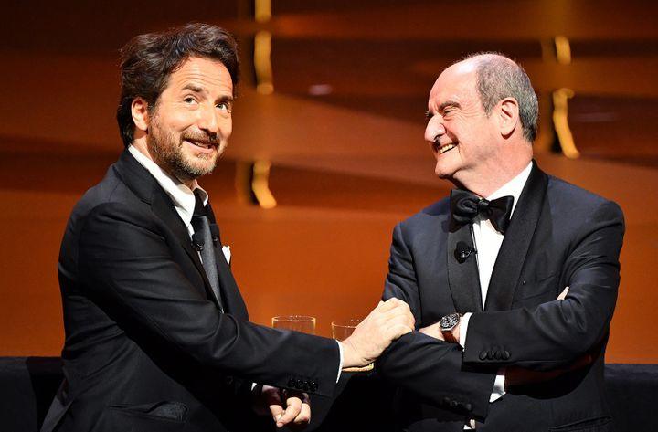 Edouard Baer et Pierre Lescure.  (ALBERTO PIZZOLI / AFP)