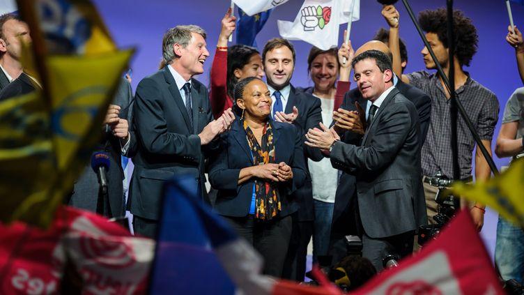 Les ministres de l'Education, Vincent Peillon, de la Justice, Christiane Taubira, et de l'Intérieur, Manuel Valls, lors d'un meeting du PS contre les extrémismes, le 27 novembre 2013, à la Mutualité,à Paris. ( MAXPPP)