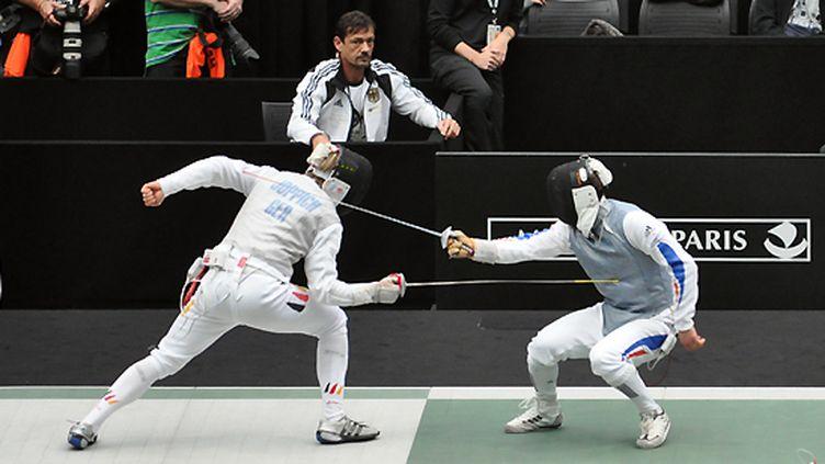 Victor Sintès touché par l'Allemand Joppich en quarts de finale des Mondiaux 2010