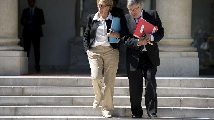 La ministre de la Réforme de l'Etat, Marylise Lebranchu, et le ministre en charge des Relations avec le Parlement, Alain Vidalies, le 30 mai 2012 à Paris. (FRED DUFOUR / AFP)