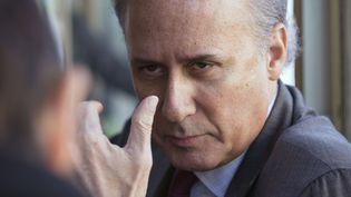 Georges Tron, maire UMP de Draveil et conseiller départemental de l'Essonne, le 19 février 2015, sur le marché de sa commune. (BERNARD BISSON /JDD /SIPA)