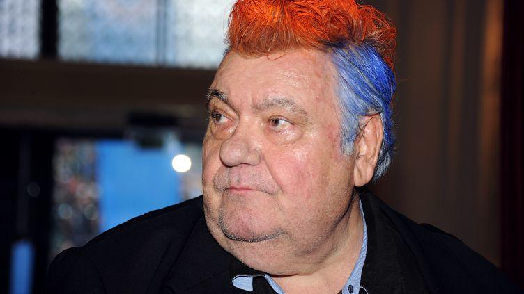 La crête rouge de Loulou Nicollin. Le président du club de foot de Montpellieravait parié qu'il porterait une crête colorée si son équipe remportait le championnat de France, le 20 mai 2012. Pari gagné ! (PASCAL GUYOT / AFP)