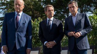Nicolas Sarkozy et François Fillon lors de l'université d'été des Républicains à La Baule (Loire-Atlantique), le 5 septembre 2015. (SALOM-GOMIS SEBASTIEN / SIPA)