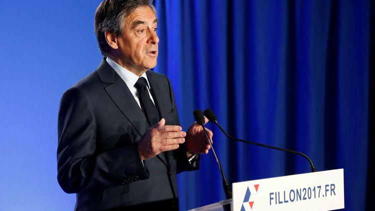 François Fillon a annoncé, mercredi 1er mars 2017 depuis son QG de campagne à Paris, le maintien de sa candidature.     (CHARLES PLATIAU / REUTERS)
