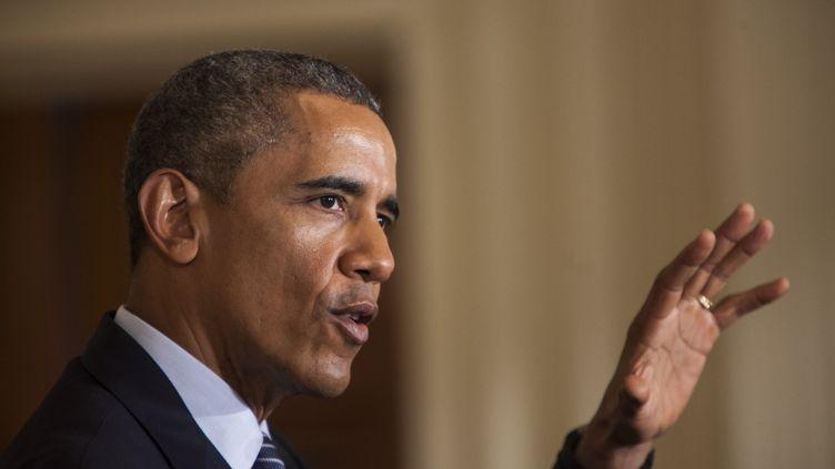 Le président américain Barack Obama présente son plan pour le climat, à Washington (Etats-Unis), le 3 août 2015. (SAMUEL CORUM / ANADOLU AGENCY / AFP)