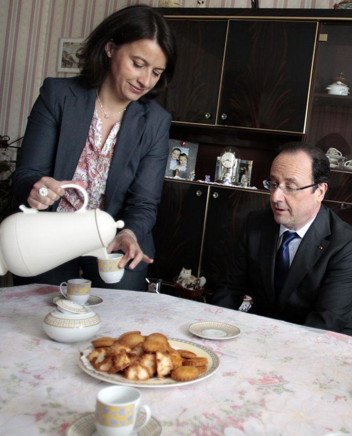 Cécile Duflot et François Hollande lors d'un déplacement à Caen (Calvados), le 17 mai 2013. (MAXPPP)