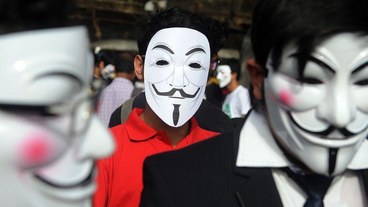 Des Anonymous à Bombay (Inde), le 9 juin 2012. (INDRANIL MUKHERJEE / AFP)
