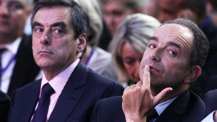 Les deux candidats à la présidence de l'UMP, François Fillon et Jean-François Copé, le 27 septembre 2012 à Marcq-en-Barœul (Nord). (ALAIN ROBERT / SIPA)