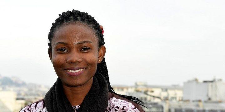 L'activiste béninoise Mylène Flicka pose à Paris le 23 novembre 2016 (ALAIN JOCARD / AFP)