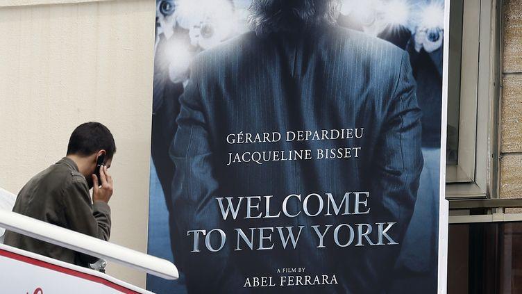 """L'affiche de """"Welcome to New York"""", le film d'Abel Ferrara. (VALERY HACHE / AFP)"""